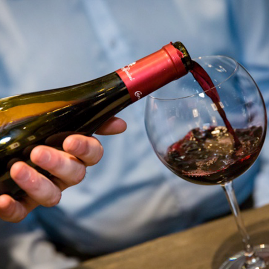Pouring red wine at Veeno at One New Change